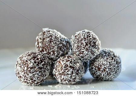 Homemade coconut rum balls on plate. Christmas sweets. Traditional homemade handmade Czech sweets.