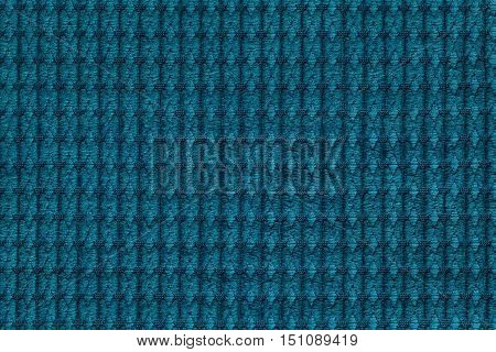Dark turquoise background from soft fleecy fabric close up. Texture of textiles macro.