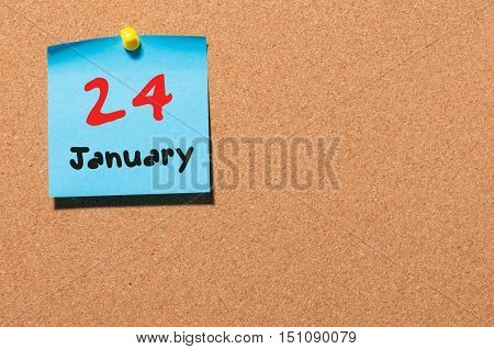 January 24th Eve Christmas. Day 24 of month, Calendar on cork notice board. New year time. Empty space for text.