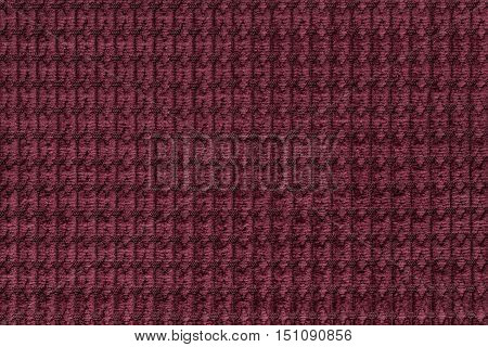 Dark red background from soft fleecy fabric close up. Texture of textiles macro.