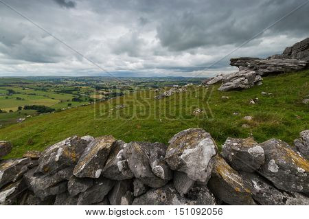 A view from Wolfscote Hill in the Peak District Derbyshire with a stone wall in the foreground