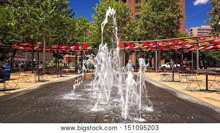 SAN ANTONIO, TEXAS - APRIL 14: A water fountain at Plaza de las Islas in downtown San Antonio, Texas on April 14th, 2016.