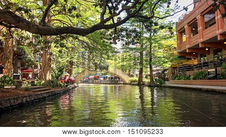 SAN ANTONIO, TEXAS - APRIL 14: View of the historic San Antonio River Walk from a boat on the river in downtown San Antonio, Texas on April 14th, 2016.