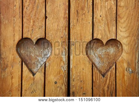 Two Heart Shapes Carved In Vintage Wood Close Up