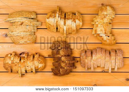 Six Sliced Loaves Of Various Breads