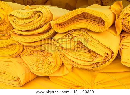 Yellow fabric roll background for industry material.
