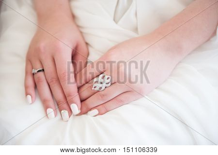 woman's hands with rings and nail polish