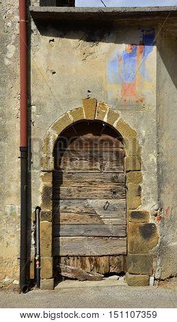 A door in an historic building in the north east Italian village of Grions Friuli Venezia Giulia