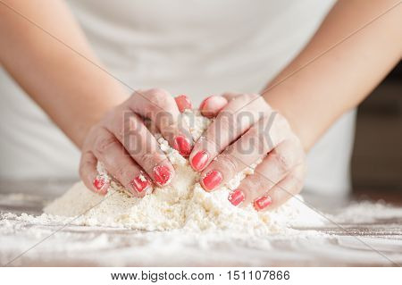 Hand Of Woman Kneading Dough For Yeast Cake On Wooden Table, Preparing Yeast Cake