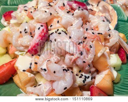 delicious fresh fruit salad with shrimp - close up