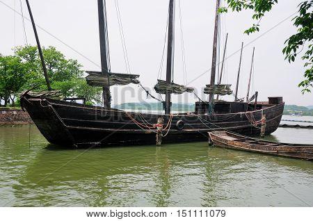 The seven mast wooden gu-boat on Lake Tai Tai hu in Wuxi China on a sunny day in Jiangsu province. poster