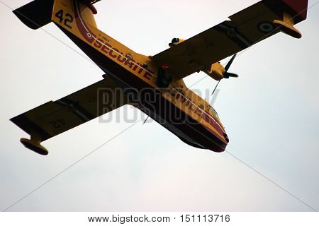 Menton France - September 9 2015: Canadair CL-415 (Securite Civile) Airplane Extinguish Forest in Flame in Menton French Riviera