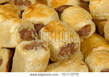 extreme close up freshly baked homemade cocktail sausage rolls