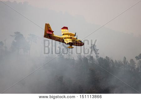 Menton France - September 9 2015: Canadair CL-415 (Bombardier 415 Superscooper) Airplane Extinguish Forest in Flame in Menton French Riviera