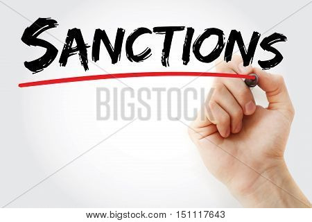 Hand Writing Sanctions With Marker
