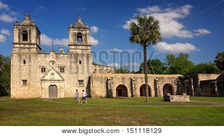 SAN ANTONIO, TEXAS - APRIL 15: Tourists visit the historic Mission Concepcion in San Antonio, Texas on April 15th, 2016.