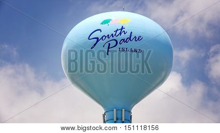 SOUTH PADRE ISLAND, TEXAS - APRIL 25: South Padre Island sign painted on blue water tower as clouds pass by on South Padre Island on April 25th, 2016.
