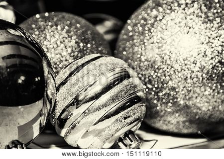 Shimmering christmas baubles. Symbolic objects. Xmas decoration. Black and white photo.