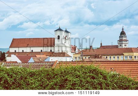 Jesuit church and Parish church of saint archangel Michael in Skalica Slovak republic. Place of worship. Cultural heritage. Retro photo filter. Travel destination.