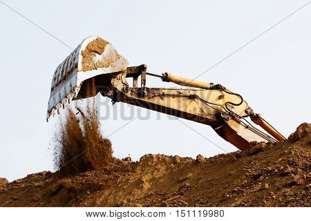 Excavator bucket on sky Industrial excavator machine
