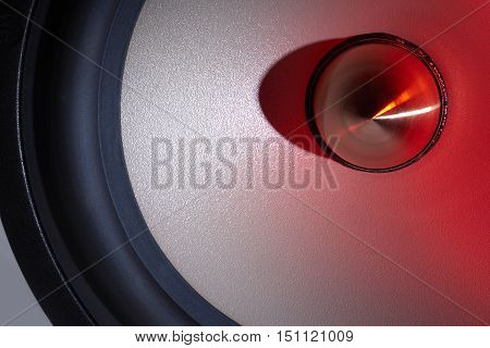 picture of a red illuminated loudspeaker detail