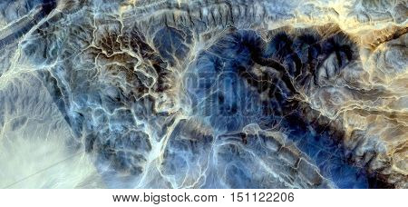 The Big Blue, mirage in the desert of Africa, abstract photography African deserts from the air, textures bluestone, blue and yellow backgrounds, branched white lines, abstract expressionism,