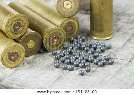 hunting bullets and lead shot on a wooden board