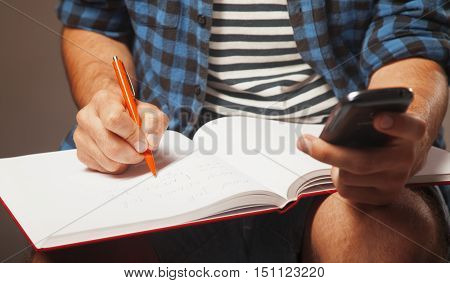 Education. Young male student preparing for exams.(self-development learning success)