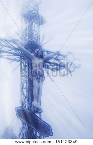 the crucifixion of Jesus Christ as a symbol of God's love for mankind (statue in snow and fog)
