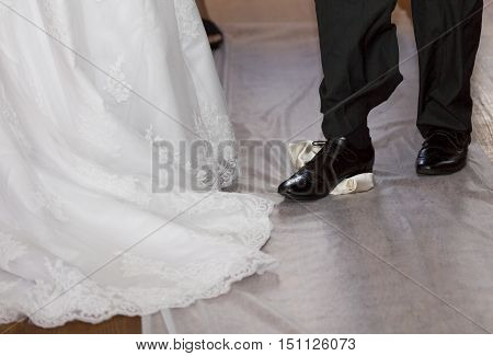 Groom breaking a glass at a Jewish wedding stamping it underfoot symbolising the destruction of the temple in Jerusalem close up of the right foot