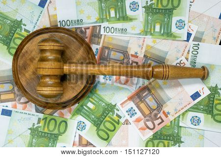 Wood gavel and soundblock on a background of banknotes