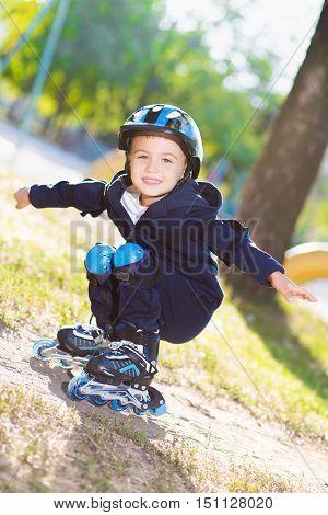 Cute Boy Rollerblading Near The Playground