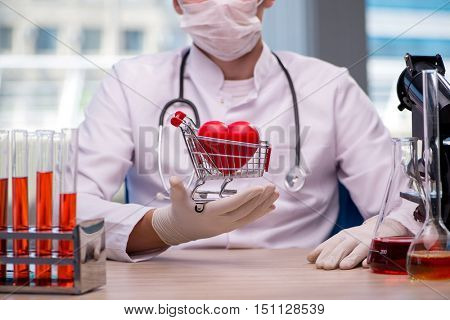 Doctor curing heart in medical concept