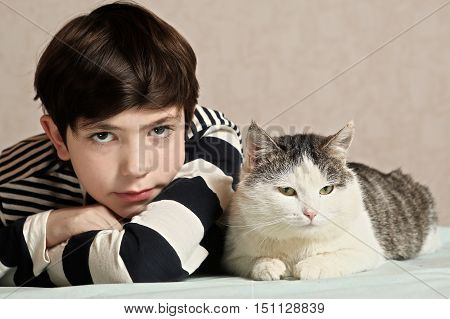 preteen handsome boy with cat close up photo