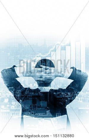 Back view of relaxing businessman looking at abstract city background with business charts. Finance concept. Double exposure