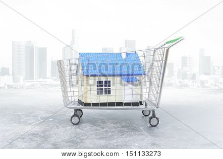 Trolley with blue house on city background. Concept of buying property. 3D Rendering