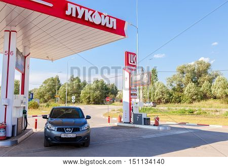 BOROVICHI RUSSIA - AUGUST 6 2016: Car Nissan Qashqai at the Lukoil gas station. Lukoil is the largest privately owned oil and gas company in the world by proved oil reserves