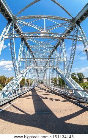 BOROVICHI RUSSIA - AUGUST 6 2016: First in Russia steel arch bridge on river Msta. Historical iron bridge. Was build in 1905