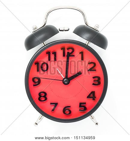 Red Clock face with black frame pointing at 2