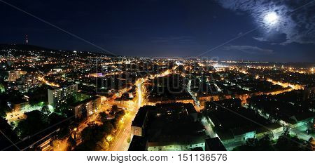 Cityscape at night with moonlight, Pecs Hungary