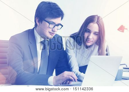 Businessman And Businesswoman In Sunlit Office
