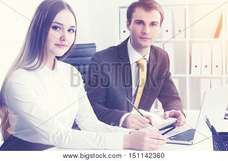 Serious Businessman And Businesswoman At Work