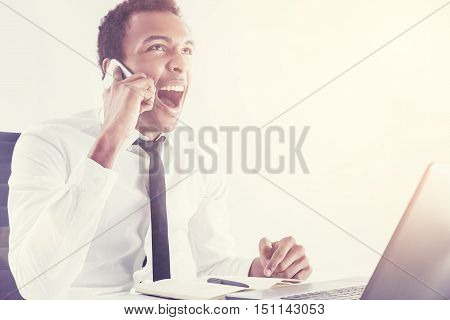 Black Man Shouting On Mobile Phone