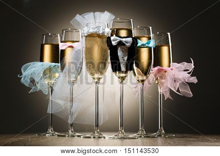 Composition of stylized glasses with champagne for wedding party