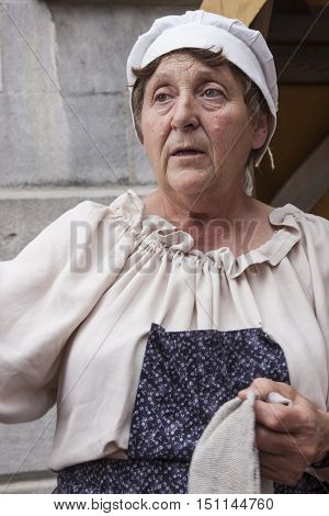 MONTREAL, QC - AUGUST 28, 2016 - An old woman at a historical reenactment event