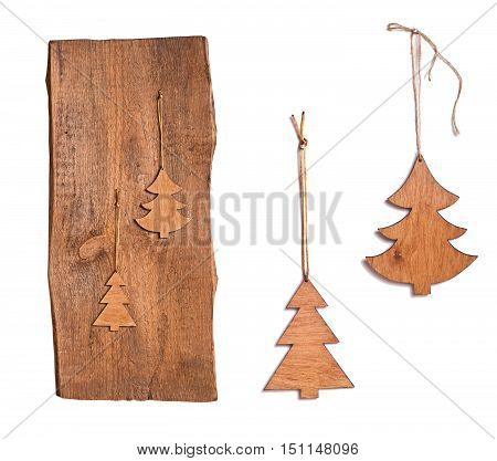 Christmas decoration. Wooden Christmas trees on old wooden board and on white background