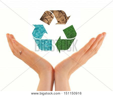 Hands of woman holding paper house with recycling symbol isolated on white