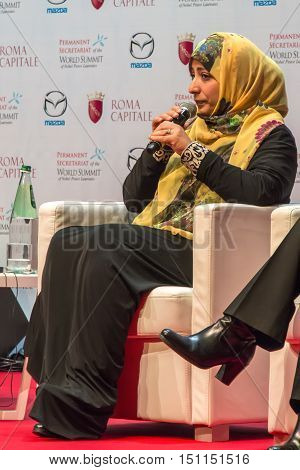 Rome Italy - December 13 2014: World Summit of Nobel Peace Laureates 2014. Tawakkul Karman Yemeni political activist during his speech at the World Conference of the Nobel Peace Laureate