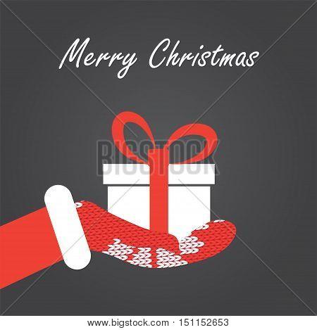 Gift box in Santa's hand. Christmas Vector illustration