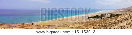 Panoramic view from above on the coast and one of the best beaches in the world Sotavento on Fuerteventura Spain.